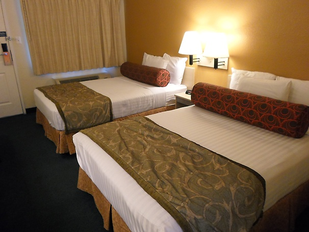 Room with two full-size beds