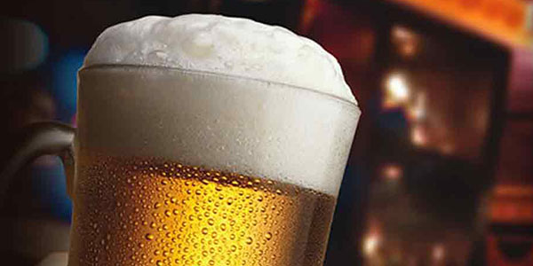 People drinking beer at bar